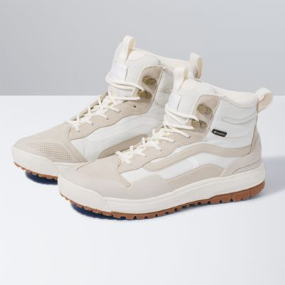 The UltraRange EXO HI MTE is one of Vans\\\' most versatile shoe design combinations, blending the comfort and get-you-there features of the UltraRange family with the protection from the elements that only the MTE franchise can provide. This new design combines the UltraRange\\\'s signature comfort UltraCush foam cushioning mid-sole with traction from MTE\\\'s reverse lug outsole, built using Vans\\\' original waffle rubber compound. On top of that, this version of the UltraRange EXO HI MTE is optimized with Invisible Fit Technology by GORE-TEX. Invisible Fit is a new kind of GORE-TEX that offers the same waterproof, windproof, and breathable benefits you expect-but in a unique, reduced-weight construction that creates an extremely comfortable fit and feel. With Invisible Fit Technology, the UltraRange EXO HI MTE GORE-TEX accommodates with superior comfort and mobility, while extending the journey for as far as your all-weather path takes you. It is made with textile, synthetic, and leather materials.