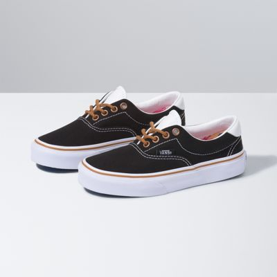 The C & L Kids Era 59, a low top lace-up skate shoe, features sturdy double-stitched canvas uppers with leather accents, metal eyelets, padded collars for support and flexibility, and signature rubber waffle outsoles.