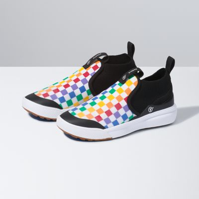 Vans\\\' first-ever shoe designed specifically with kids\\\' needs in mind, the Checkerboard Kids XtremeRanger expands the comfort and performance story by building on the UltraRange bottom unit while successfully targeting durability and an easy on/easy off experience. The playful design also features a rainbow checkerboard print, an UltraCush midsole, and a knitted bootie construction made with breathable textile and synthetic materials, making this the perfect choice for kids.