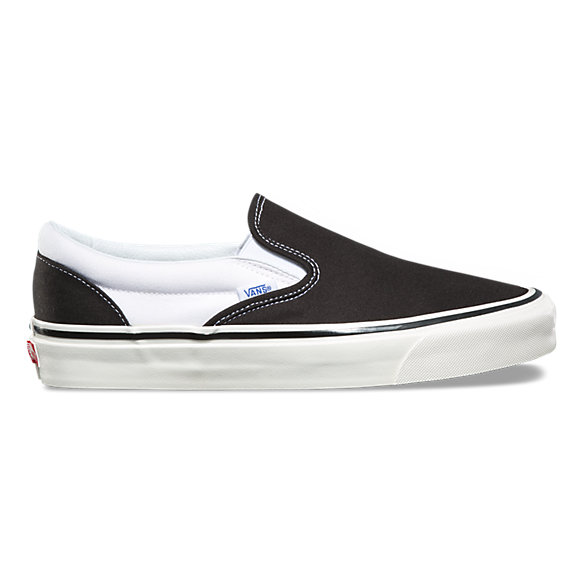 black and white slip on vans