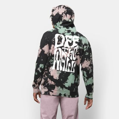 The Hell Yeah Tie Dye Pullover Hoodie is an 80% cotton, 20% polyester fleece pullover hooded sweatshirt with an allover tie dye, a front pouch pocket, and graphics at the left chest and back. Model is 6 feet tall and wearing a size Medium.