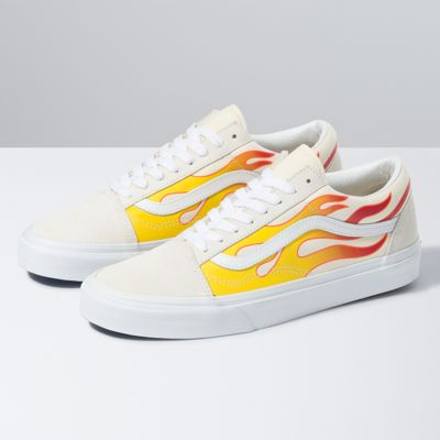 The Flame Old Skool, the Vans classic skate shoe and first to bare the iconic sidestripe, is a low top lace-up featuring sturdy suede and printed canvas uppers, re-enforced toe caps to withstand repeated wear, padded collars for support and flexibility, and signature rubber waffle outsoles.