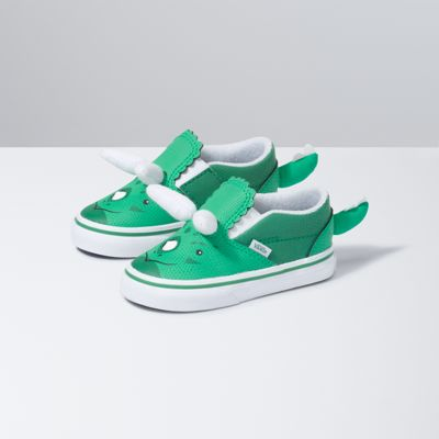Release your wild side with the Toddler Triceratops Slip-On V! Featuring the three mighty horns of a Triceratops plus a tail on the heel to complete the look, this style will let you live out your dinosaur Jurassic dreams. The Toddler Triceratops Slip-On V also features a hook-and-loop closure, a heel pull for an easy-on/off fit, padded collars, elastic side accents, and signature rubber waffle outsoles.