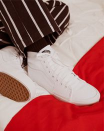 Cameron's shoes as focal point on bed